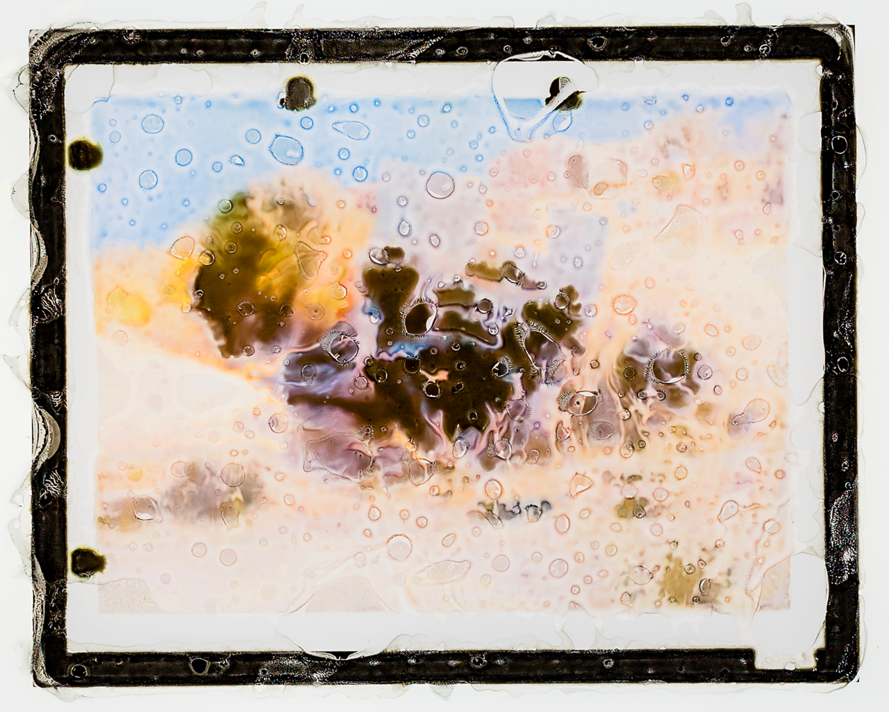 Humvee. Haditha, Iraq. November 19, 2005 [312133 JAN 13 Misprint], 2013. Inkjet monoprint transparency in lightbox, 8 x 10 1/2 inches. Note: The problems of reference and truth are addressed in the titling convention. There, I reconsider referentiality to an event through rupture. Photographs record an event, Misprints produce very unstable images. Each work corresponds to a specific  time and space, with a unique set of irreversible  circumstances.